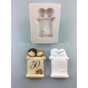 Mold of Babies with wedding ring.
